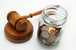 judge's legal gavel and coin jar with money